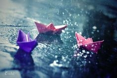 Paper boats sailing in the rain <3