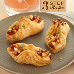 Golden puff pastry envelopes are filled with an appetizing combination of feta, cranberry chutney and walnuts to make these sweet and savory delights. A perfect fall appetizer.