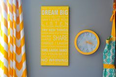 Family Rules on our wall in yellow on a gray wall. With gray clock, chevron curtains and a nice apron. :) kitchen color, color contrast, woman decor, famili rule