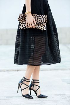 black skirt, leopard clutch