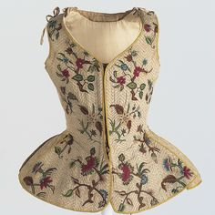 Waistcoat first half of the 18th century crafted from linen and silk with polychrome embroidery.