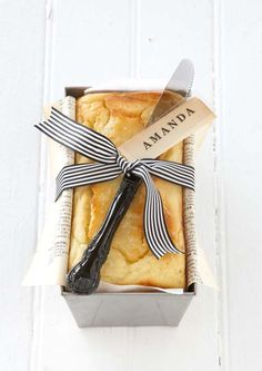 Love this!  Give baked goodies in pan lined with newspaper and ribbon with personalized tag (stamp).  Recipe for lemon yogurt cake.