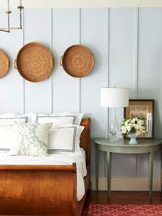 Basket Art  For a casual cottage look, hang shallow wicker baskets along a wall as artwork. Here, the woven baskets add texture to the wall, and the natural material pops against cool blue walls.