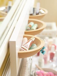 cut wooden bowls in half and mount on a painted board to organize small items