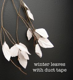 """This is the easiest project ever. You know those winter Christmas """"picks"""" you can buy in the floral department? Don't buy them because you can make them. DUCT TAPE winter leaves @nesters"""