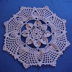 Irish Pineapple Filet Doily $1.99 or 5000 Points  Designed by Julie A. Bolduc    This doily combines versions of 3 types of crochet techniques. Irish Crochet, Filet Crochet and pineapples. It works up fairly quickly. You could complete it in a couple of evenings or if you like to crochet all day, it will take just a few hours.