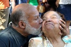 Journalist Ron Howell and his mother Marian Baker Howell — Bertram Baker's daughter — celebrate their joy over the renamed street with a kiss. Marian Baker Howell still lives in the neighborhood. Live where history was made...BECOME A HOMEOWNER!
