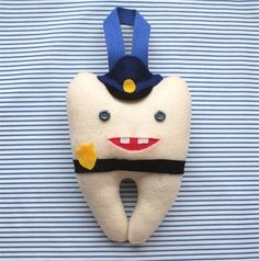 tooth pillow police officer / just too cute and couldn't be anymore fitting for me.