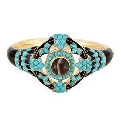 Antique Gold, Banded Turquoise and Black Enamel Bangle Bracelet   The gold bangle with one round banded agate is encircled by numerous small round cabochons of  turquoise,  an openwork scalloped outline, decorated with black enamel and round and pear-shaped cabochon turquoise, flanked by round and pear-shaped turquoise and black enamel, accented by an engraved flower motif, the reverse with glazed compartment, approximately 31 dwt. Inner circle 6 1/2 inch