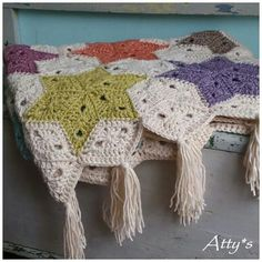 http://www.ravelry.com/patterns/library/star-blanket-5