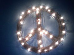 Wreaths are a forever classic DIY light craft. Get a grapevine wreath (bonus points for a peace sign shape!), and wrap LED lights around the branches.