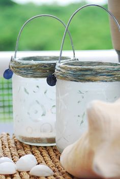 Re-purposed SALSA JARS as Outdoor Lanterns. Jars, twine, ModPodge, acid etching, and wires. Lovely.