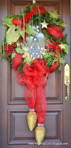 mesh bow accented with ornaments- looks like tassels on a wreath