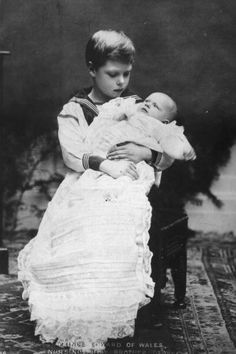 The Duke of Windsor (King Edward VIII) as a boy, holding his baby brother Prince John