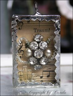 Silver soldered trinket box with vintage bling and old German sheet music background