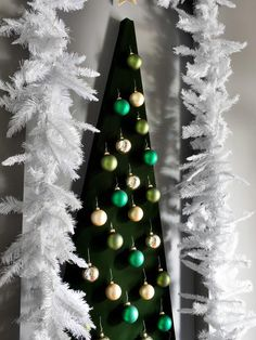 Decorating for a small space?  Try this contemporary #Christmas tree alternative from @Casey Noble  #HolidayHouse