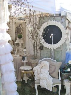 vintage booth. love tulle ruffled curtain and framed chalkboard.     Use the outside chairs