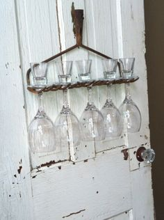 wine glass holder.  put several rakes on an old door or something framing them and hang on wall.