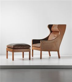 BØRGE MOGENSEN Wingback armchair, model 2204, and ottoman, model no. 2202, designed 1964, executed 1970s
