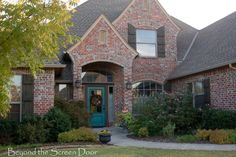 Love the turquoise front door. She tells how she painted it.