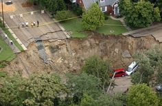 Richmond, Va., 2004. A sinkhole gapes in Richmond, Va., on Aug. 31, 2004. The collapse was caused by heavy rain from the remnants of Tropical Storm Gaston. The unexpected downpour led to widespread flooding that left at least five dead and devastated a historic neighborhood. Mark Gormus / Richmond Times-Dispatch via AP