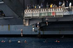 CANNON BALL! #Sailors aboard USS Dwight D. Eisenhower jump from the aircraft carrier during a swim call. Ike Sailors are deployed to the U.S. 5th Fleet promoting maritime security.