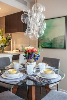 House of Turquoise: Sarah-Marie Interior Designs - contemporary round glass dining table with gray chairs