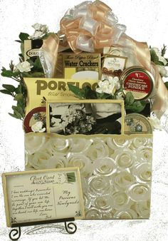 Help to celebrate their wedding day with this big and beautiful basket filled with an entire host of delicious gourmet snacks, sweets and gifts  This large and elegant wedding gift basket features a beautiful white rose design gift box; it will bring smiles and ever-lasting memories to that special happy couple. $88.99 http://www.littlegiftbasketboutique.com/item_742/Wedded-Bliss-Wedding-Gift-Basket.htm
