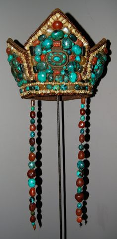 Ceremonial Tibetan headdress mostly worn in West Tibet and Ladakh. | Early to mid 20th century | Leather,  turquoise, coral, agate and mother of pearl || Price on request Another tourist market item made in the late 80's. Many have found their way into museums , cataloged as authentic but are not.