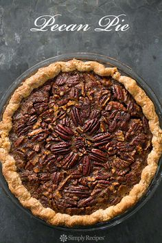 Traditional pecan pie with fresh pecans, molasses, corn syrup, brown sugar, and eggs. Perfect for Thanksgiving! On SimplyRecipes.com