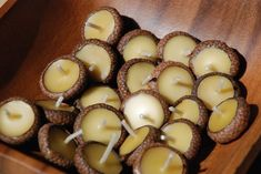 Floating beeswax candles in acorn hats! 10 for $10 on Etsy.