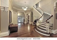 Curved staircase; taupe/grey paint; dark wood & white trim