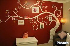 """not a big fan of the dark color, but love 1: the parents' initials in the tree trunk and 2: the picture frames """"hanging"""" from the branches"""