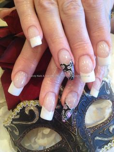 White French acrylic nails with freehand valentines love heart freehand nail art