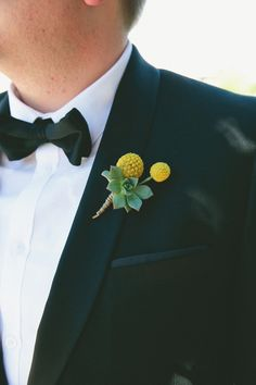 billy button #boutonniere! photo by Onelove Photography http://ruffledblog.com/1920s-inspired-ace-hotel-wedding #weddingideas #groom