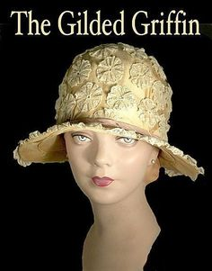 This peach silk and lace covered cloche is a magnificent example of an early Art Deco fashion. With a Paris and New York label, it is unusual as the brim is made from finely hand-woven straw, which remains in superb, supple, mint condition. Although straw was a more predominate medium during the mid-20s, the slightly droopy brim silhouette dates this hat to circa 1920-21