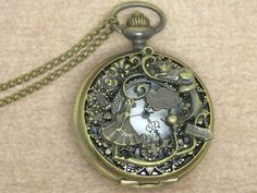 Alice in wonderland pocket watch necklacewith antique by galengift, $3.80