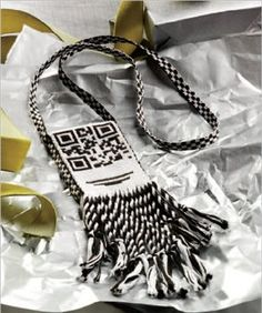 This tablet-woven QR code bag by Michael Cook will not only hold small items, it is also embellished with a secret message that can be read with a smart phone. #tablet_weaving