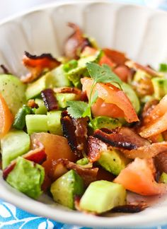 Paleo Bacon Avocado Salad       1 Avocado, cut into 2-inch chunks  4 Slices Uncured Apple-Smoked Bacon  1 Tomato, cut into 2-inch chunks  1 Cucumber, peeled and sliced  2 Tablespoon Fresh Cilantro, chopped  1 Tablespoon Olive Oil  Salt & Pepper      Heat the olive oil in a medium sized frying pan over medium heat. Add the bacon and grill, flipping every few minutes, until they are nice and crispy. Remove the bacon from the pan and reserve the drippings inside the pan
