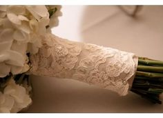 Bouquet. Wrapped with a piece of moms wedding dress. Love this!