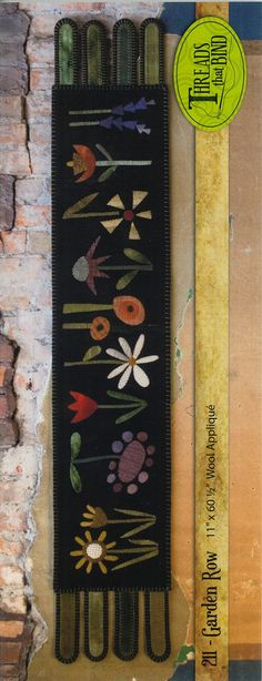 Hey, I found this really awesome Etsy listing at https://www.etsy.com/listing/178316839/garden-row-wool-applique-penny-rug
