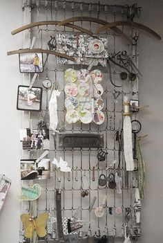 This is brilliant!  Repurposed metal bed springs used as craft room / jewelry organizer. Perfect!