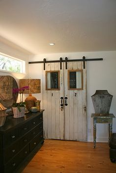 Love the rustic barn door closet doors. I would paint the track. It takes away from the doors.