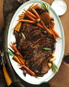 Braised brisket with carrots, garlic, and parsnips.