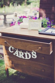 A chest of drawers transforms into a welcome table. As seen on www.intimateweddings.com/blog #weddingsigns