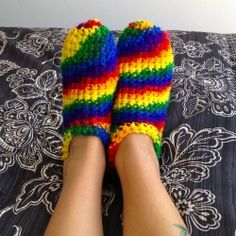 Keep your feet cozy with these super easy crocheted rainbow slippers.