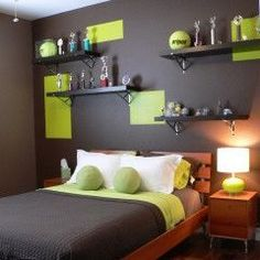 AJ. super cool grey walls & colour blocked green (we'd do orange), sections over wall.  Great headboard for teen (easily moved, not too bulky). Would definitely need added light fixtures with all walls darker colours.