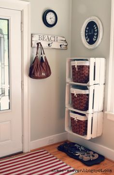 Crates on the wall with baskets inside; need to do along the basement stairs!