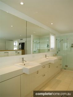 Clean-cut lines and bright whites are a cool bathroom renovation idea to create a fresh bright atmosphere in your home.