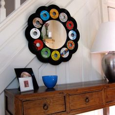 The 45RPM Mirror is composed of 12 recycled 7'' records that frame a beautiful mirror. Chosen according to the artist's color preference, the vinyl records circle and frame a mirror with a 10.5-inch diameter. Weighing in at a hefty six pounds, this handmade mirror is as sturdy as it's striking. Vinylux proves that vinyl records can continue to inspire, long after the music has died down.